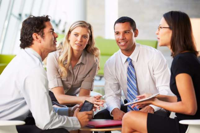 correcting-leadership-communication-mishaps-co-workers-talking-workplace